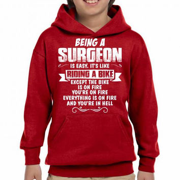 being a surgeon Youth Hoodie