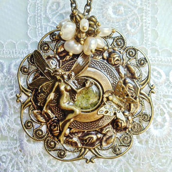 Fairy filigree pendant with layers of bronze rings and floral filigree, with bronze butterfly and cream freshwater pearls