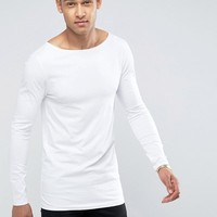 ASOS Longline Muscle Long Sleeve T-Shirt With Boat Neck In White at asos.com