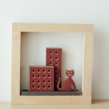 Cat and the city wall decor, red cat with tall buildings in wooden frame, table- wall decor, ceramic cat and buildings in light color frame