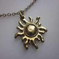 Tribal Sun Charm Necklace in Antique Gold by lovespelljewels