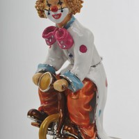 Happy Circus Clown on Unicycle