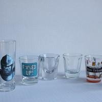 Seven Assorted Shot Glasses Lot, 2 Planet of the Apes, 2 Clear, 1 New Orleans, 1 Art Deco, 1 F'd Up, Vintage Bar Glass