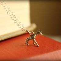 Itty Bitty Giraffe Necklace in Sterling Silver by saffronandsaege