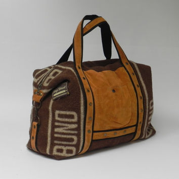 Wool and leather travel bag with double front pocket, made from a wool blanket and leather jacket