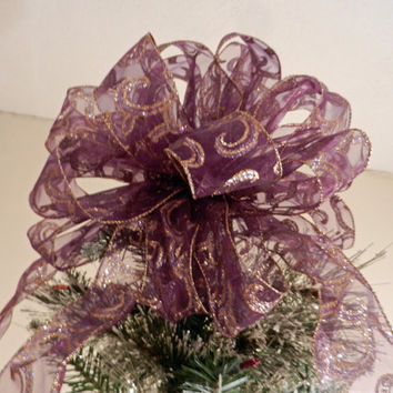 Large Christmas Tree topper bow made with a  sheer purple ribbon with  gold swirls and 8 ornament bows