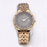 Gruen Gold Styled with Fuax Diamonds Circular Analog Gold Band Mens watch