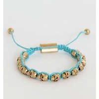 Turquoise Bracelet with Gold Skulls