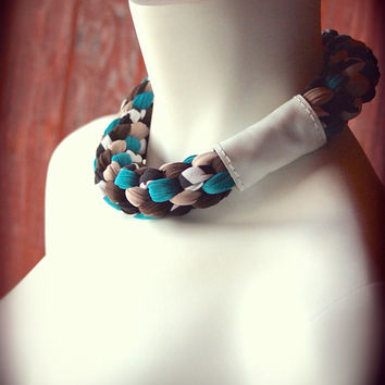 eye-catching choker jersey necklace in shades of teal, black, and white - woven necklace with leather band - ready made by Needless Studio