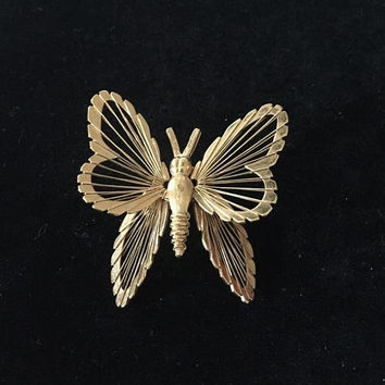 Vintage Monet butterfly brooch piano string wings Gold toned