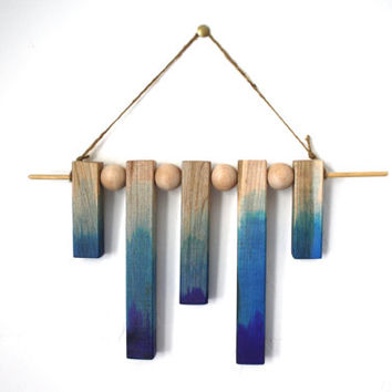 Neutral and Blue wall hanging in wood