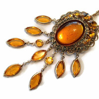 Dangle Bezel Set Crystal Pendant Necklace Brooch with Large Amber Color Cabochon and Gray and Honey Rhinestones Gold Tone Signed Hobe'