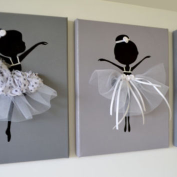 Dancing Ballerinas Wall Art. Set of three dancing ballerinas in white.