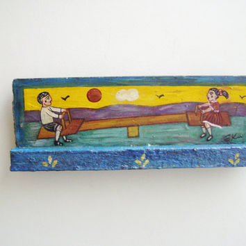 Children on seesaw, vintage, folk painting of boy and girl on a seesaw, Greek folk art, art brute, salvaged wood painting, early nineties