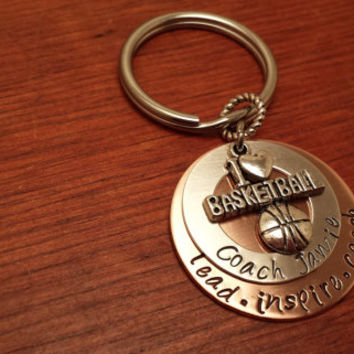 "Hand stamped basketball coach's key chain with saying. ""lead, inspire, coach"""