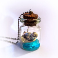 Seal on an iceberg in the ocean, bottle necklace, vial pendant, winter scene