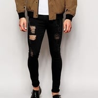 ASOS | ASOS Extreme Super Skinny Jeans With Extreme Rips at ASOS