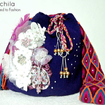 Wayuu Mochila bag decorated with stones and wall lamps made by hand