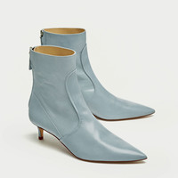 MID-HEEL LEATHER ANKLE BOOTS
