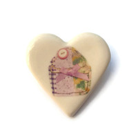 Ceramic jewellery brooch with image of my textile cupcake printed and glazed onto the surface in a heart shape