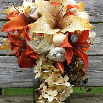 Gorgeous rustic bouquet, tiger lily's, hydrangeas, broaches with pearl and rhinestone accents