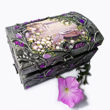 Hand decorated silver jewelry box.