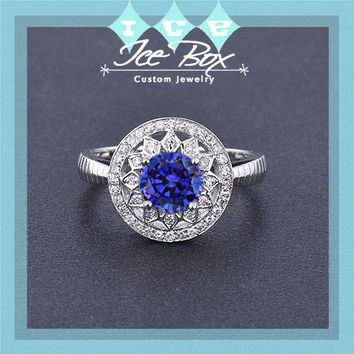 Cultured Blue Sapphire Engagement Ring .75ct, 6mm Round Cultured Blue Sapphire in a 14k White Gold Diamond Halo Setting