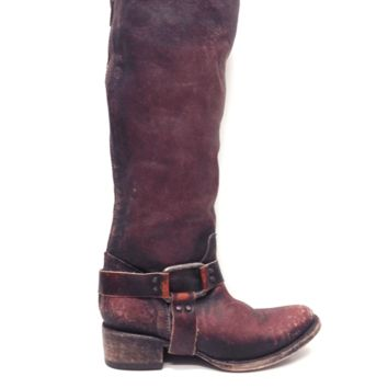 Western-inspired boots have a hard-worn look in scuffed, variegated leather. Exposed zip secures the back. Distressed, stacked heel and leather sole.