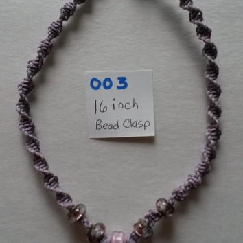 Lavender hemp cord with glass beads and pink, white and clear flower pendant