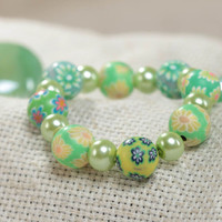 Beautiful children's handmade polymer clay wrist bracelet of green color