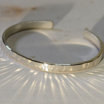 Hammered thick sterling silver cuff bracelet with elegant radiance