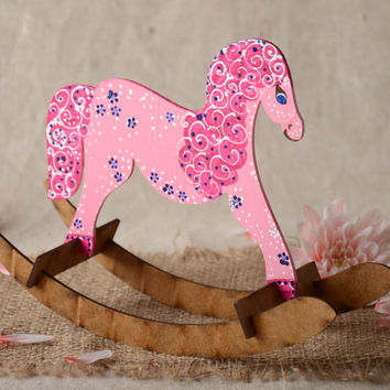Children's handmade painted wooden toy rocking horse of small size