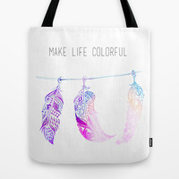 triple feathers Tote Bag by deppo