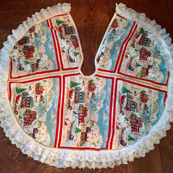 Lovley Vintage Handmade reversible quilted christmas tree skirt. Gold trim, lace, Sleighs, figures ice skating, quaint homes.