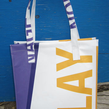 Vinyl tote bag made from recycled billboard