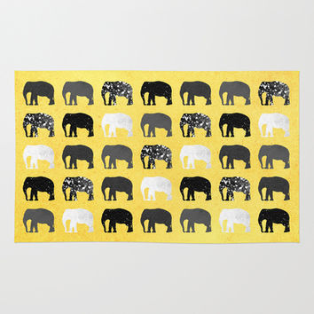 Five elephants / Gold Area & Throw Rug by Elisabeth Fredriksson | Society6