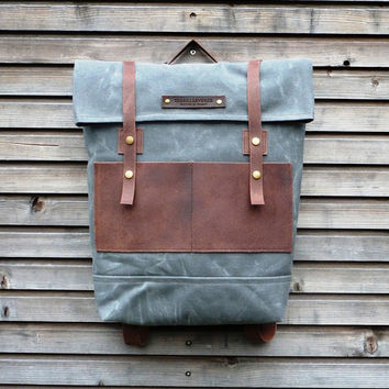 Waxed canvas backpack / rucksack with folded top and waxed leather shoulderstrap