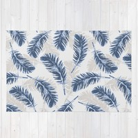 My blue feathers Rug by Juliagrifol Designs