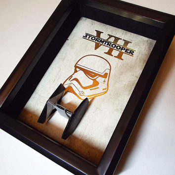 Star Wars Force Awakens First Order Stormtrooper Poster Art. 5X7 Shadowbox Framed Art Includes Shiny Foil Print And A Tie Fighter Figure.