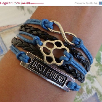 ON SALE Infinity bracelet Dog paw bracelet, best friend bracelet, Antique silver charm, black Braided and blue wax cords, sister best friend