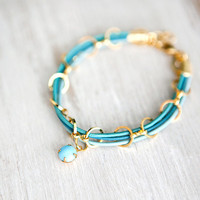 Mint Green Leather Bracelet with Golden chain and small blue bead by pardes israel
