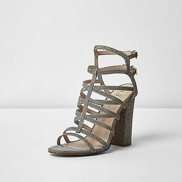 Metallic caged heels