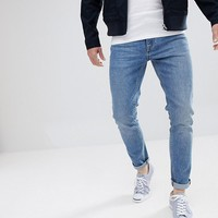 ASOS Skinny Jeans In Vintage Mid Wash at asos.com