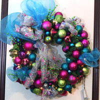 Christmas Wreath in Hot Pink, Turquoise, Lime Green, and Purple on a lighted green pine garland wreath; Bright and Lively