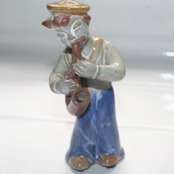 Man Playing Music Blue and Brown Figurine