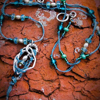 Silver wire, braided thread and Czech glass bead pendent with knotted blue/grey thread, teal color glass and silver beaded necklace.