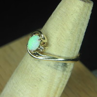 $150.00   opal and diamond ring 10k size 7