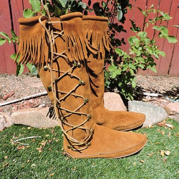 Knee high moccasin boots / size US 6 / vintage Minnetonka USA made / boho hippie tall festival moccasin boots / fringed leather moccasins