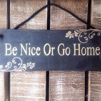 funny sign. funny gift. be nice or go home. hallway. kitchen decor.