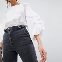 ASOS DESIGN Farleigh high waist slim mom jeans in washed black with western buckle tab at asos.com